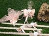 Εικόνα με Λαδοσέτ βάπτισης με λουλούδι και ροζ φιόγκο
