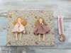 Εικόνα με Βιβλίο ευχών φλοράλ με κούκλες
