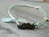 Εικόνα με Δίχρωμο μαρτυρικό βραχιόλι μουστάκι