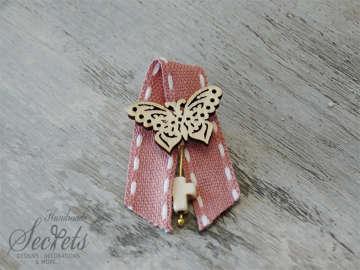 Εικόνα του Μαρτυρικό πέτου με πεταλούδα