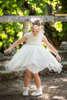 Φόρεμα μεσάτο με λεπτομέρειες βαμβακερής δαντέλας και πέρλες στην μέση.