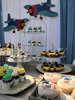 Στολισμός και candy bar με θέμα τα παιχνίδια με θεματικά γλυκά και στολισμός με ξύλινα στοιχεία.