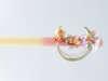 Εικόνα με Πασχαλινή λαμπάδα νεράιδα στο φεγγάρι